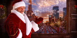 The man in costume of santa claus over night city background. Christmas, holidays, gesture and people concept - The man in costume of santa claus over night city Royalty Free Stock Image