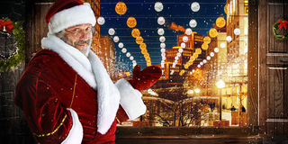 The man in costume of santa claus over  night city. Christmas, holidays, gesture and people concept - The man in costume of santa claus over  night city Stock Photography