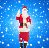 Man in costume of santa claus pointing finger up Stock Images