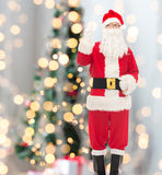 Man in costume of santa claus pointing finger up Royalty Free Stock Image