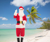 Man in costume of santa claus pointing finger up Stock Photo