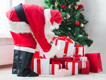 Man in costume of santa claus with presents Royalty Free Stock Image