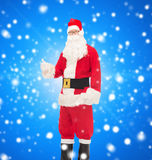 Man in costume of santa claus showing thumbs up Royalty Free Stock Images