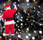 Man in costume of santa claus writing something Royalty Free Stock Photography