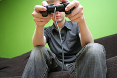 Man on couch playing video games Royalty Free Stock Images
