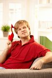 Man on couch with slipper Stock Photo