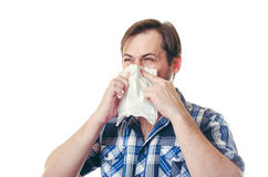 The man cough in a snivel scarf. The man in a blue cough  shirt with a beard on cheeks cough in a snivel scarf Royalty Free Stock Photos