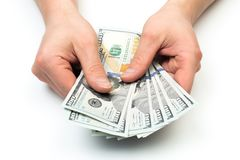 Man count the new us dollars isolated on white royalty free stock image