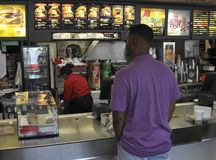 Man at counter at Mcdonalds ordering royalty free stock photo