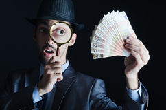 Man with counterfeir money Stock Photography