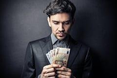 Man counting banknotes Royalty Free Stock Image