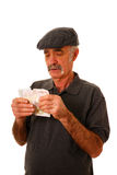Man counting British pounds. Man counting ten pound notes isolated on white royalty free stock image