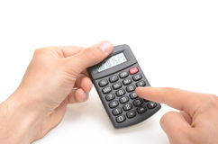 Man counting on calculator. Isolated on white Royalty Free Stock Images