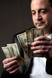Man Counting Cash Royalty Free Stock Photos