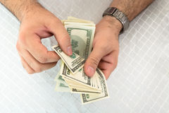 Man counting dollar notes Royalty Free Stock Photos