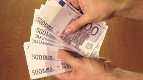 Man counting five hundred euro banknotes. Savings, salary or spending concepts Royalty Free Stock Photography