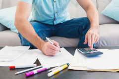A man counting his bills at home Royalty Free Stock Photos