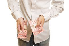 Man Counting Money. Torso of a man counting Canadian money Royalty Free Stock Image