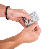 Man counting money. Close up of man counting money on a white background stock images
