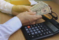Man counting money in home office Stock Images
