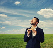 Man counting money and looking up Royalty Free Stock Photo