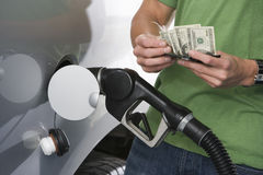Man Counting Money While Refueling Car Royalty Free Stock Photography