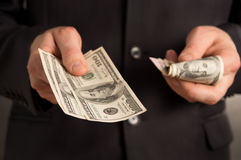 Man counting your money. On a black background stock photos