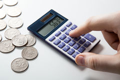 Man counts budget on a white Stock Photography