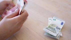 Man counts cash. Man counts money cash on table stock video