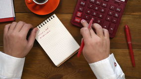 Man Counts Earnings. Businessman Counts Earnings And Writes In Diary. Business Concept stock footage