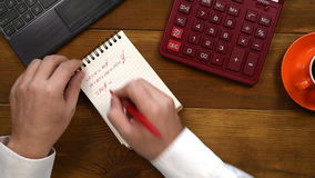 Man Counts Earnings. Trader Counts Earnings And Writes In Diary. Business Concept stock footage
