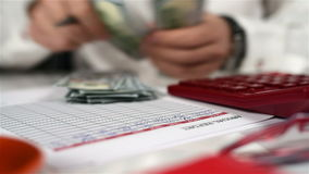 Man Counts Money. Accountant Man With Calculator Counts Dollars. Banking Concept. Close Up stock footage