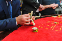 Man counts the money in the casino Royalty Free Stock Photo