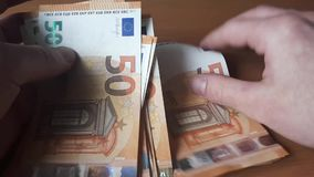 Man counts money. Euro banknotes in hand stock video footage