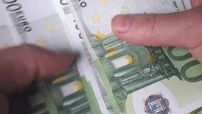 Man counts money. Euro banknotes in hand stock video