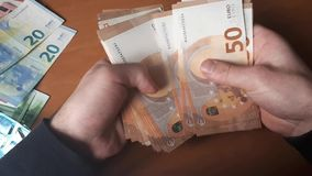 Man counts money. Euro banknotes in hand stock footage
