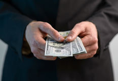 Man counts  money and gives Stock Photography