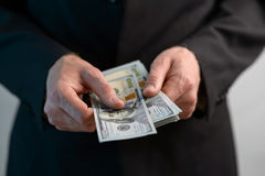 Man counts  money and gives Royalty Free Stock Image