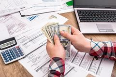 man counts money for office work and computer Royalty Free Stock Photo