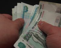 The man counts the money. Russian rouble. Human hands are visibl Royalty Free Stock Photo