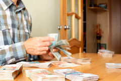 Man counts money Stock Photography
