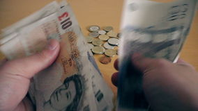 The man counts money at the table. British Pound stock video