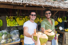 Man Couple Drink Coconut Cocktail On Street Traditional Fruits Market stock images