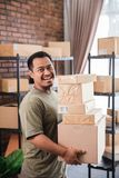 Man courier holding package work at shipping package business stock images