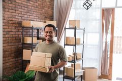Man courier holding package work at shipping package business stock photography