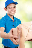 Man courier with packages royalty free stock photo