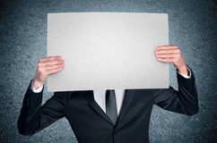 Man cover face with with board Royalty Free Stock Photos