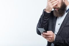 Man cover face phone business failure money loss. Frustrated man covering face holding phone. business failure and money loss. mobile banking and online royalty free stock photos