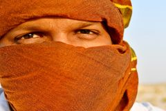 Man Cover Face Using Scarf Stock Image