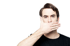 Man cover his mouth,  speak no evil concept. Stock Images